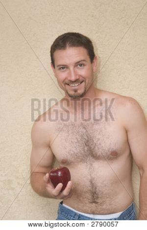 Smiling Handsome Shirtless Man Smiling Into Camera, Holding An Apple