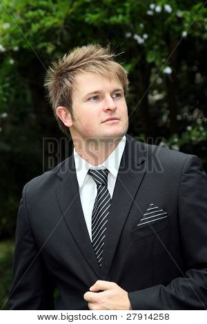 Handsome Young Man In Suit And Tie