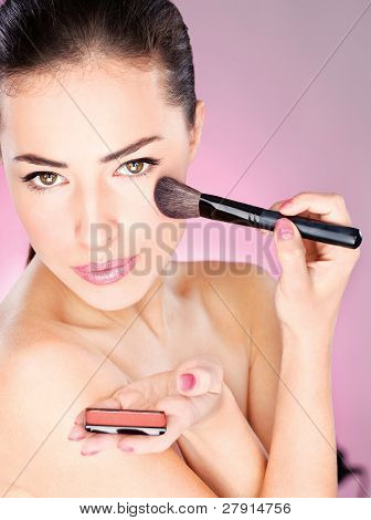 Woman Applying Cosmetic Powder Brush