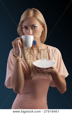 Blond Sensual Woman With Tea Set