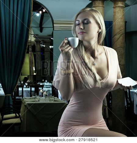 Blond Sensual Woman Enyoing Coffee