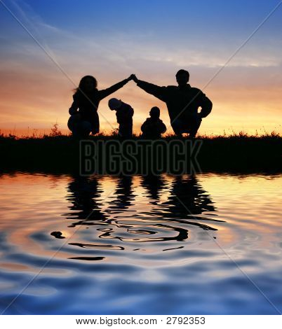 Children In Parents House On Sky. Water