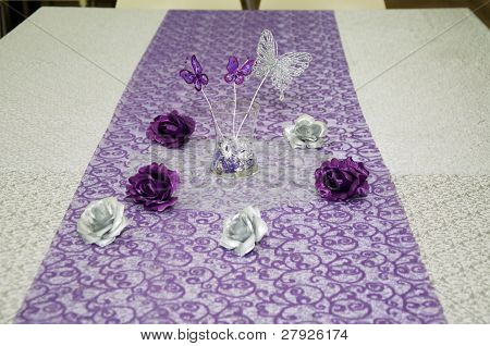 Celebratory table with butterflies and roses