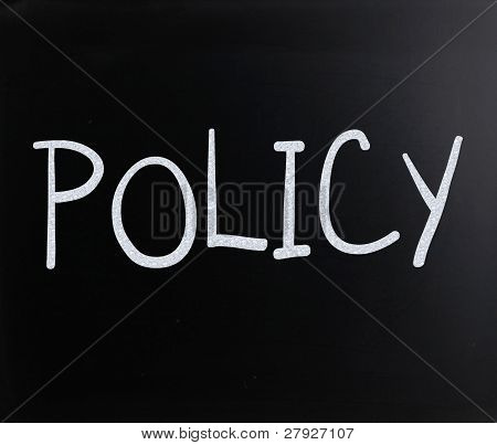 "The Word ""policy"" Handwritten With White Chalk On A Blackboard"