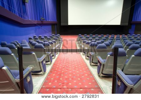 Empty Cinema Auditorium With Black Cordon With Blue Walls