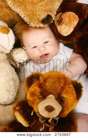 Baby With Several Teddy Bears