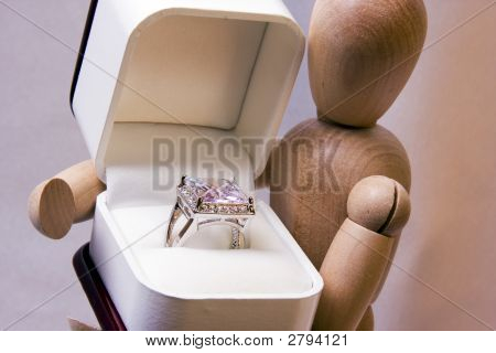 Woodman Holding Ring In Box