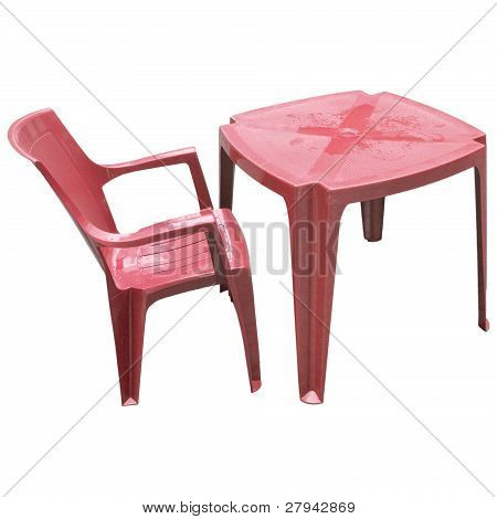 Red plastic table and chair isolated