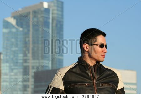 Asian man in motorcycle jacket, urban