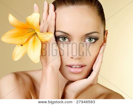 Beautiful portrait of the sexual girl on a beige background