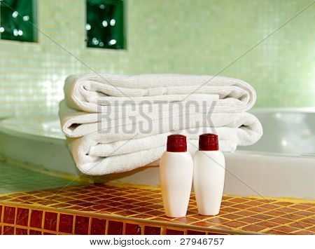 Towel, shampoo and gel in a bathroom