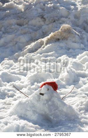 Small, Red-Capped Snow Man