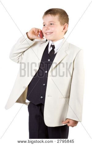 Well-Dressed Boy Like Businessman Calling At Phone