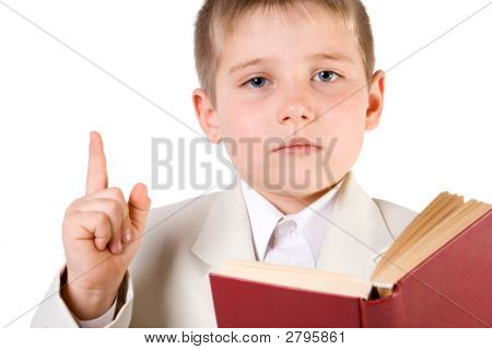Well-Dressed Boy Read Book And Lift Finger Up.