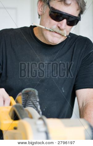 Carpenter Using Power Saw