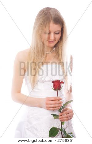 Young Smiling Bride Look To Red Rose