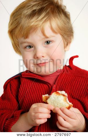 Boy Eating A  Peanut Butter And Jelly Sandwich