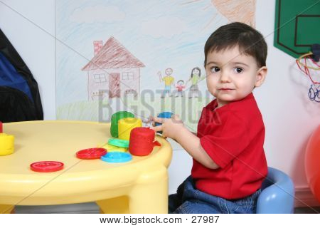 Adorable Preschooler Playing With Colorful Dough