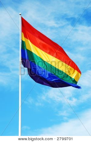 Rainbow Gay Pride Flag On The Blue Sky