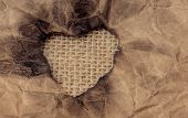Heart Shaped Burnt Out Of A Brown Paper poster