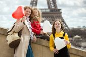 Mom And Daughters On The Background Of The Eiffel Tower poster