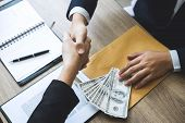 Dishonest Cheating In Business Illegal Money, Businessman Handshake Money Of Dollar Bills In Hands F poster