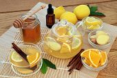 Flu and cold remedy herbal medicine ingredients with ginger, cinnamon, eucalyptus oil, lemon and ora poster