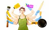 stock photo of homemaker  - An overworked very busy multitasking housewife under stress - JPG