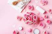 Aromatherapy, Spa, Beauty Background With Roses Flowers, Cosmetics And Candles On Pink Table. Flat L poster