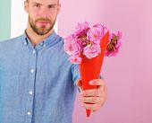 This Is For You Macho Gives Flowers As Romantic Gift. Boyfriend Confident Holds Bouquet Flowers. Guy poster