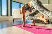 Home fitness woman doing yoga plank in living room on mat in small apartment- girl planking knee to  poster