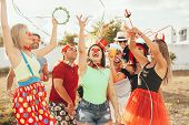Brazilian Carnival. Group Of Brazilian People In Costume Celebrating The Carnival Party In The City poster