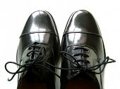 stock photo of black tie  - black leather polished shoes - JPG