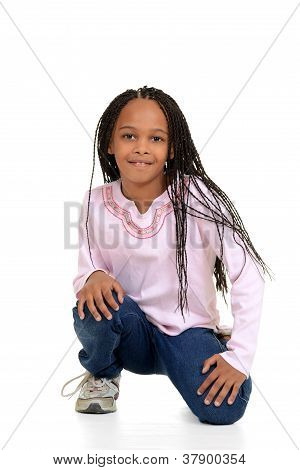Black girl with corn rows sitting