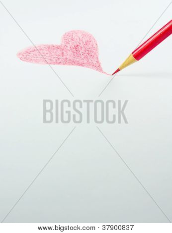 Red Colour Pencil With Love Shape Drawn On Plain White Paper