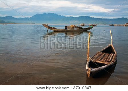 Landscape With Boat, Mountains And Clouds Cau Hai Lagoon (thua Thien Hue, Vietnam)
