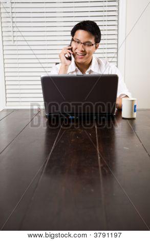 Asian Entrepreneur On The Phone