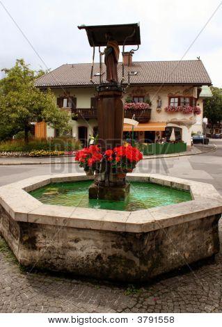 A Typical Bavarian Fountain In Garmisch-Partenkirchen