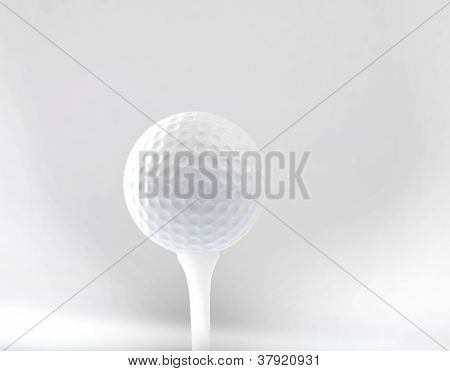 golf ball on tee and grey space background