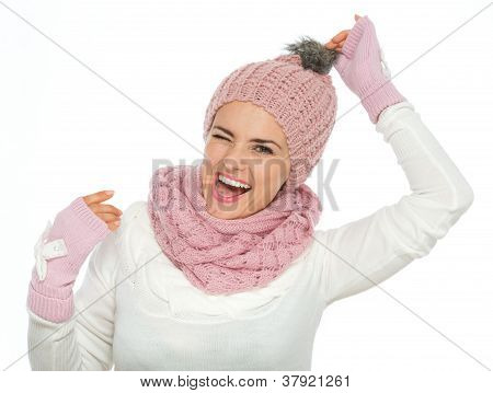 Cheerful Young Woman In Knit Winter Clothing Holding Pompom