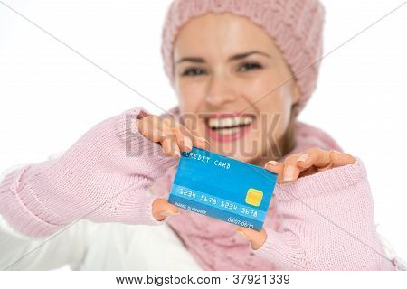 Closeup On Credit Card In Hand Of Woman In Winter Clothing