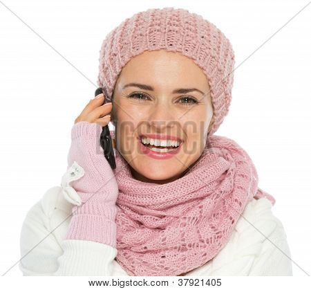Happy Woman In Knit Winter Clothing Making Phone Call