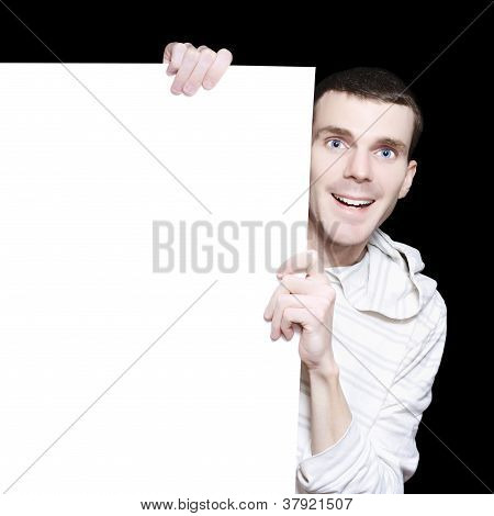 Smiling Man With Blank Board On Black Background