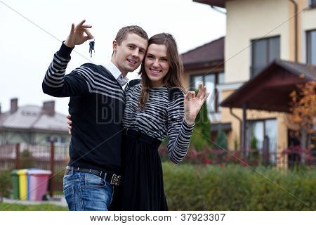 Young Family With The Keys On New Home