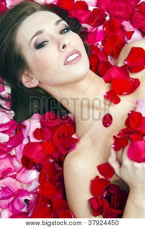 Woman In Rose Petals