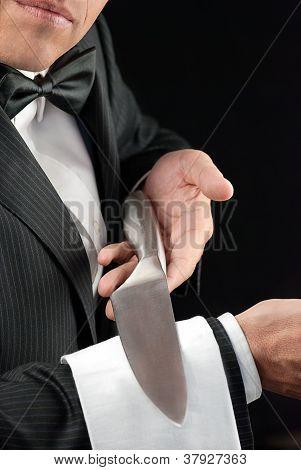 Fine Dining Waiter Presenting Knife