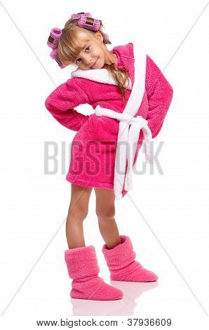 Little girl in pink bathrobe