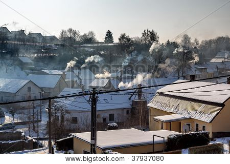 Non Ecologic Smoking Chimneys In Small Village