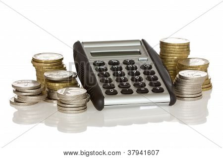 Calculator And Stack Of Coins