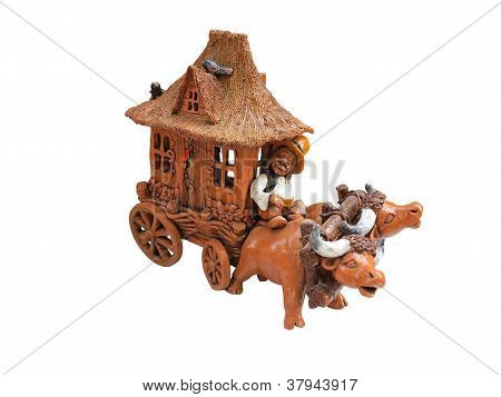 Clay Figurine Oxen And Covered Wagon Isolated Over White